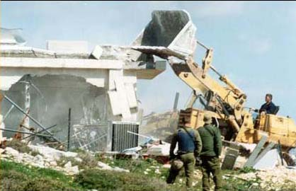 caterpillar_bulldozer_destroying_palestinian_home