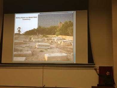 Hazem Jamjoum presents on the colonization of space in Palestine. In one particularly brazen example, Israel desecrated a Palestinian cemetery by permitting a Hilton hotel to be constructed upon it.