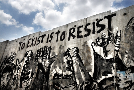 Tulkarem. North of West Bank ( Occupied Territories), Palestine.   A part of the wall shows a graffiti  saying 'To Exist is to Resist', an important resistance motto in Palestine. Tulkarem, West Bank, Palestine. 2006.